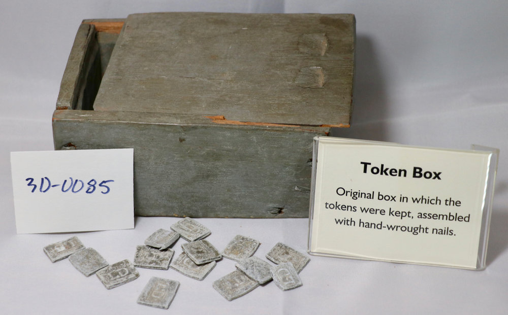 In the historic Presbyterian years, parishioners who could prove themselves worthy in advance would receive a token; placing one's token in the box was required to receive communion.