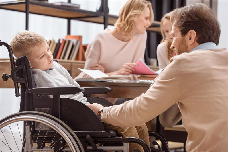 Disabled Child with Parents.jpg