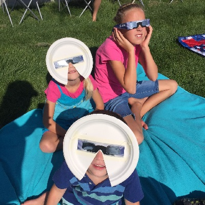 Three of my kids watching the solar eclipse, August 21, 2017. Rigby, Idaho.