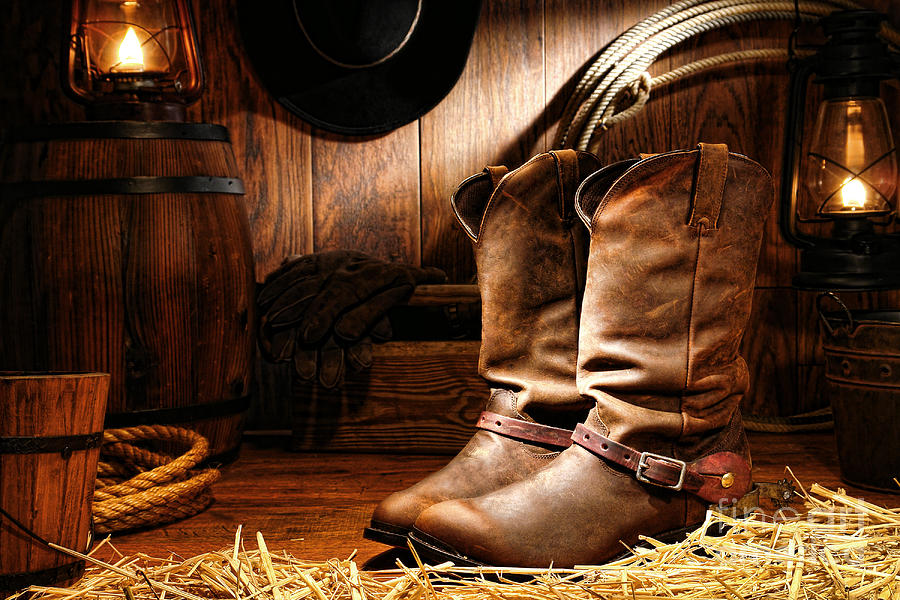 cowboy-boots-in-a-ranch-barn-olivier-le-queinec.jpg