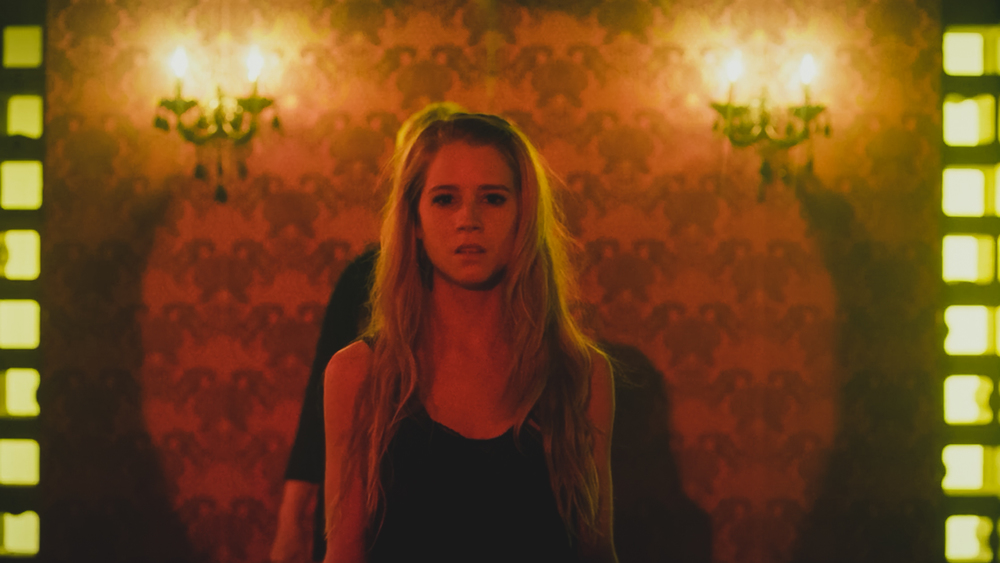 Skye (Cassidy Gifford) is auctioned at a Greek brothel in CAGED NO MORE.  Photo By: CAGED MOVIE LLC.  Download This Photo