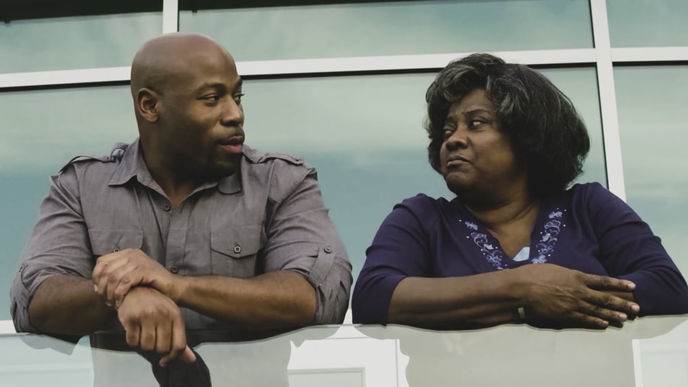 Tyler (Anthony Evans) and Aggie (Loretta Devine) discuss Aggie's faith in God.  Photo By: CAGED MOVIE LLC.  Download This Photo