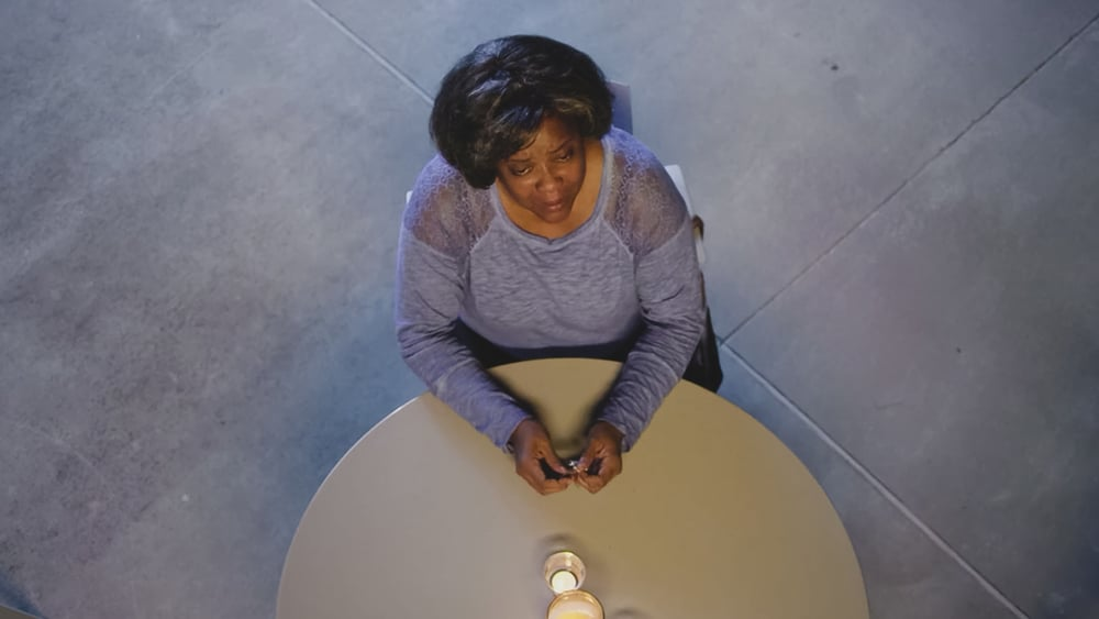 Aggie (Loretta Devine) praying for the safety of her goddaughters, Skye and Elle.  Photo By: CAGED MOVIE LLC.  Download This Photo