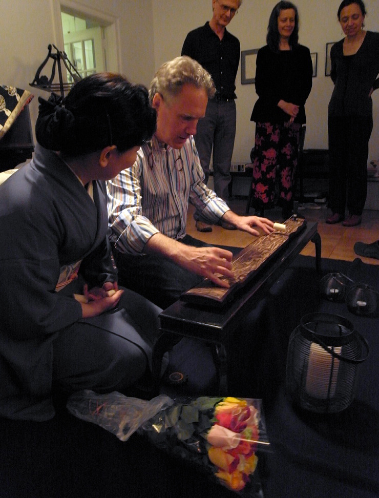 Benjamin playing the ichi-genkin with mastter Issui-san and composers Scott Johnson, Elizabeth Brown, and poet Elena Rivera looking on.