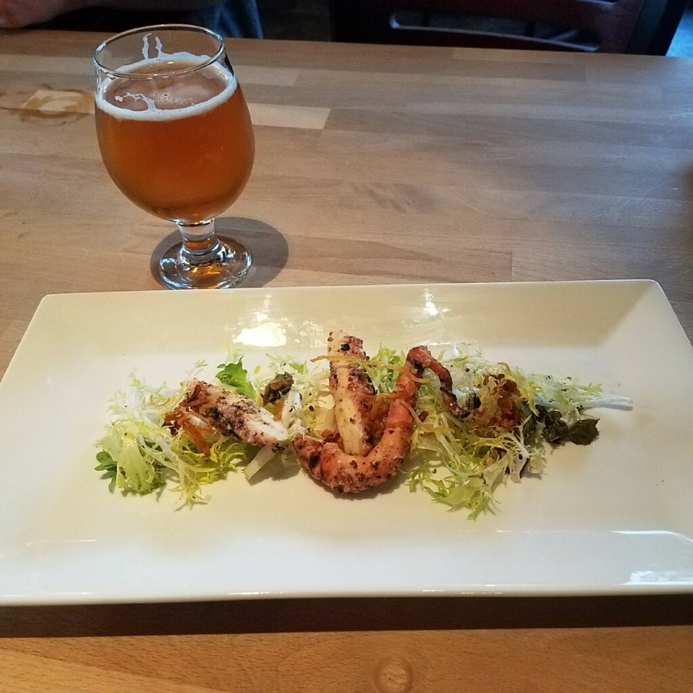 Course #1: Grilled Marinated Octopus with whole grain mustard vinaigrette and crispy shallots ove Frisse paired with Steeped Emperor's Lemon Saison