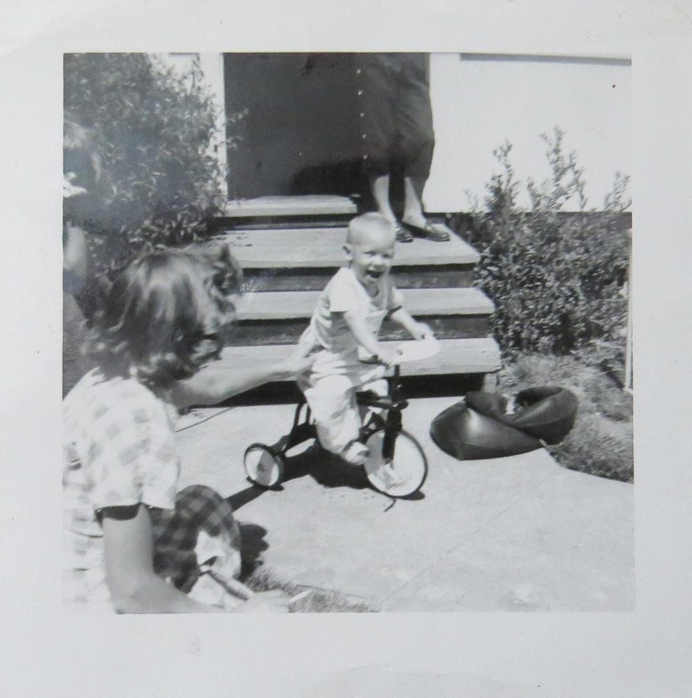 That's me, Happy on a tricycle,  even after polio and a plethora of childhood illnesses. Such absolute delight in the moment.