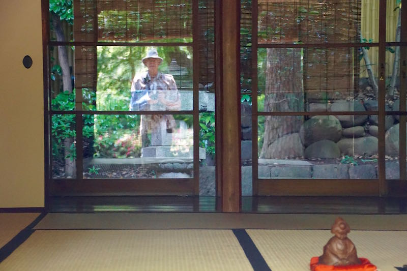 Photo taken of my reflection with broken arm in a sling while at the Happoen Garden in Tokyo on June 5, 2017.