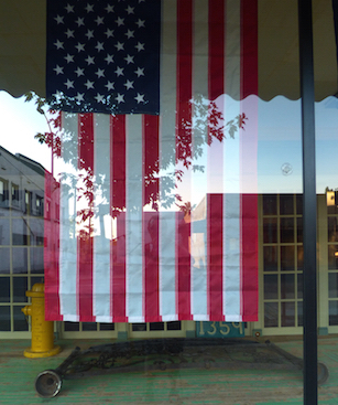 I took this ph0to about 3 years ago at a storefront in Oroville, CA. If you look closely, you can see my reflection in the flag.