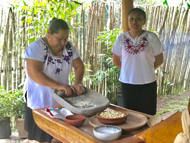 Hand-grinding the corn for the tortilla-making lesson