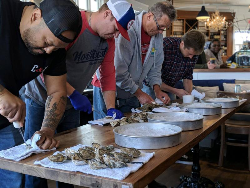 SoDel employees competing in an oyster shuck-off are (l-r) Maurice Catlett, winner; Charles Armstrong; Chris Lippa; and Brian Hutchinson. SUBMITTED PHOTOS