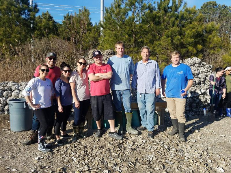 Employees of Catch 54 in Fenwick Island joined fellow SoDel Concepts restaurants workers to assemble more than 700 bags of oyster shells used to restore area watersheds. Shown are (l-r) Jana Susenaceva, Ronnie Burkle, Lauren Herlihy, Julie Hemp, Charles Armstrong, Brian Hutchinson, Chris Lippa and Brendan Hutchinson.