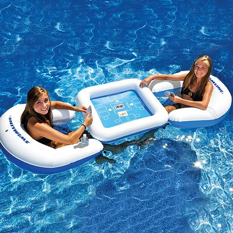 Floating Card Game Station   Now you don't have to stop playing your game of Poker or Go Fish when you want to get in the pool. This floating card table comes with waterproof playing cards, inflatable seats, and drink holders. You're all set!