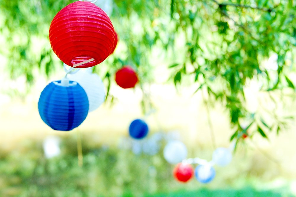 Red, White, and Blue Lanterns   Hang these over your patio, around your pool, and in your trees because nothing is more celebratory than Chinese lanterns. String Christmas lights around the area as well to create a beautifully, festive environment.