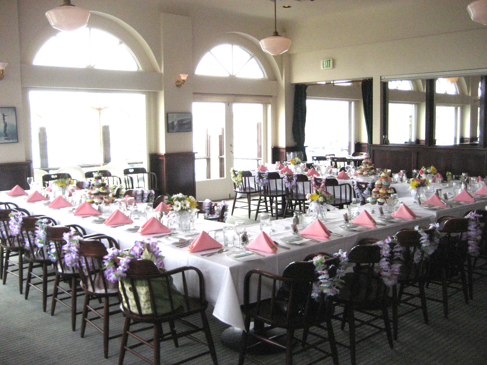 Banquet Room with Leis, Pink Napkins & Fresh Flowers