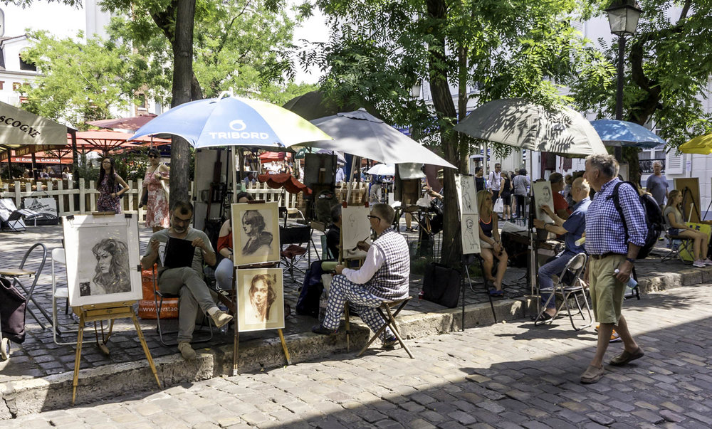 An image I took during a weekend trip to Paris, France recently. Walking slowly during a very hot day found us at a street artist market place just behind the Sacre Coeur.