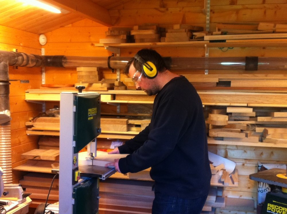 Our first workshop where it all began in a 3m by 3m log cabin at the end of our garden.