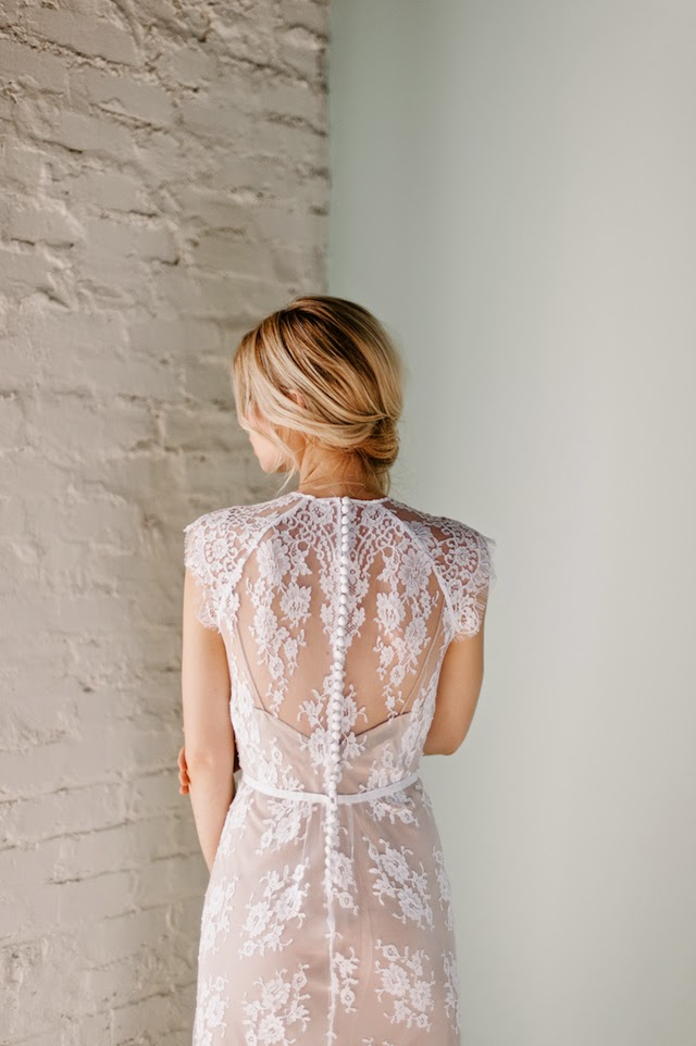 buttons down the back of a boho lace wedding dress