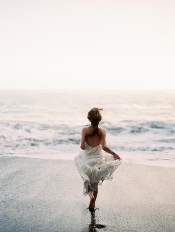 erich-mcvey-ginny-au-running-bride-shot-beach-wedding-ideas.png