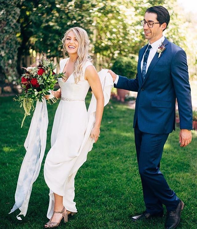 Our kind of man 💯 And bride of course! Our San Diego bride @ash_mo is radiant in her @houghtonnyc gown, and we love this sweet capture by @ken_kienow of her husband helping her out with her train❤️ Winner! #realdresstheorybrides