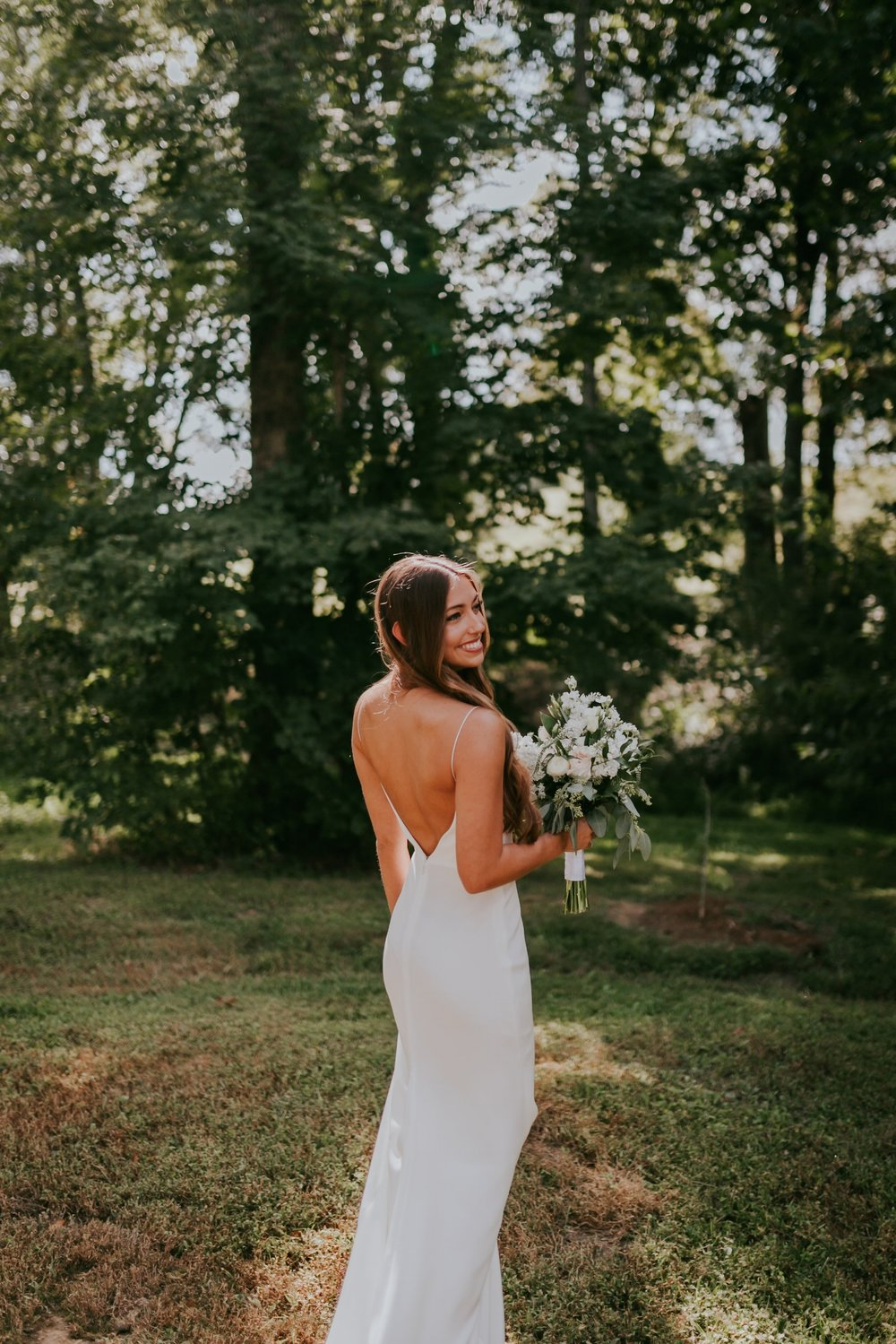 a46a3046bb687 We are completely smitten over these photos of our Nashville bride Corey  and her Alexandra Grecco wedding gown!!! Her wedding dress had a clean, ...