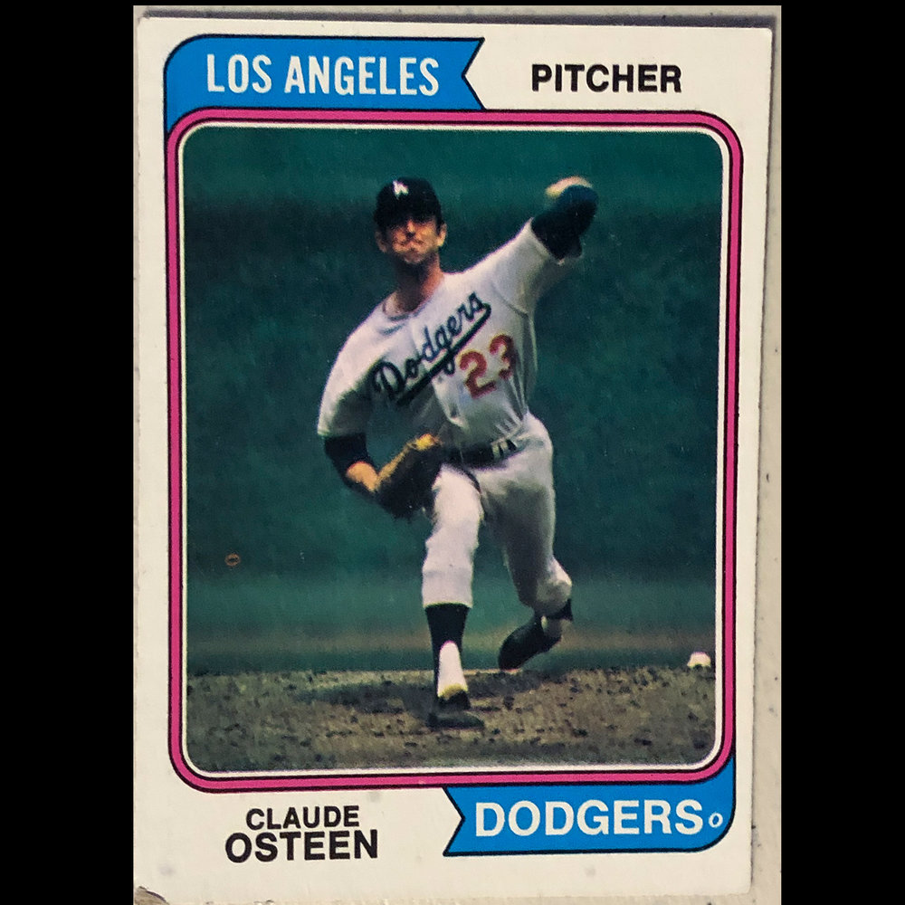Calude Osteen pitching in Wrigley Field.  I remember getting this card as a kid and being excited with how good an action image this was.  For all I know it is of a warm-up pitch but I love the angle and fact it is in Wrigley Field my favorite park.