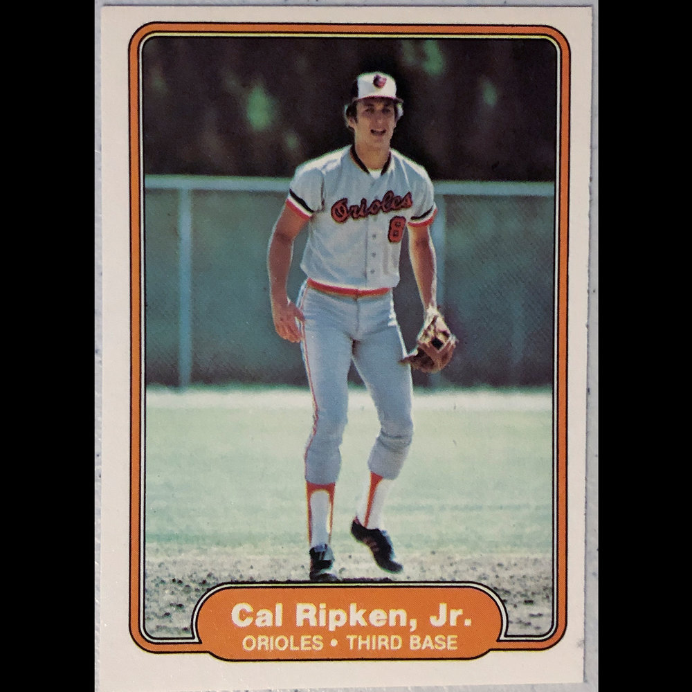 Cal Ripken Jr's Rookie Card - The photo is from infield practice I assume somewhere in Florida during the Grapefruit League.  When you look at how important his career was it's ironic his first card is so boring.
