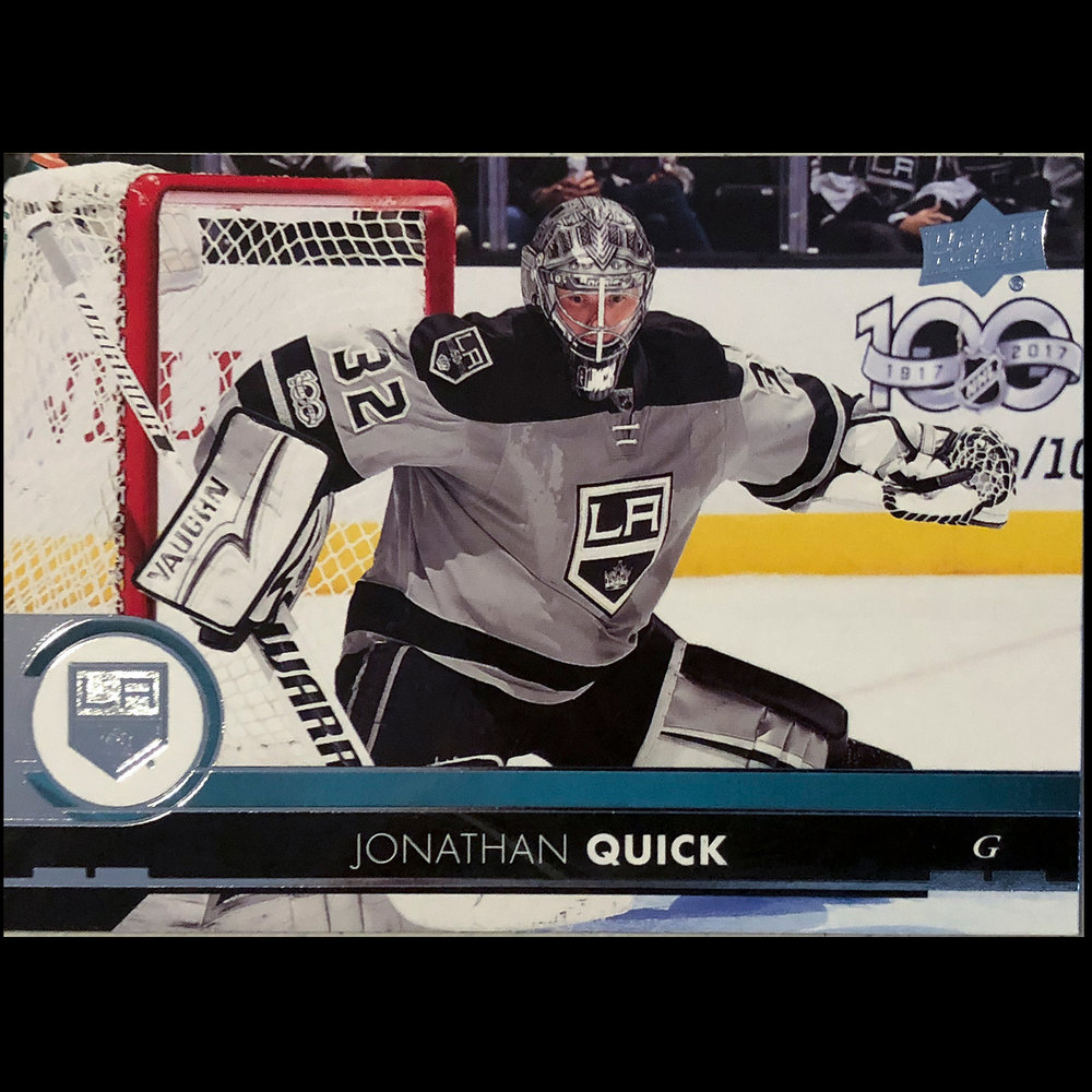 I love this image, not only because it is of Jonathan Quick the Kings' goalie, but also because of all the information in it and the framing.  Love the 50th Anniversary jersey with the NHL 100th Anniversary logo in the background.  The technology of modern cameras and strobes shows through here as does the photographer's skill.
