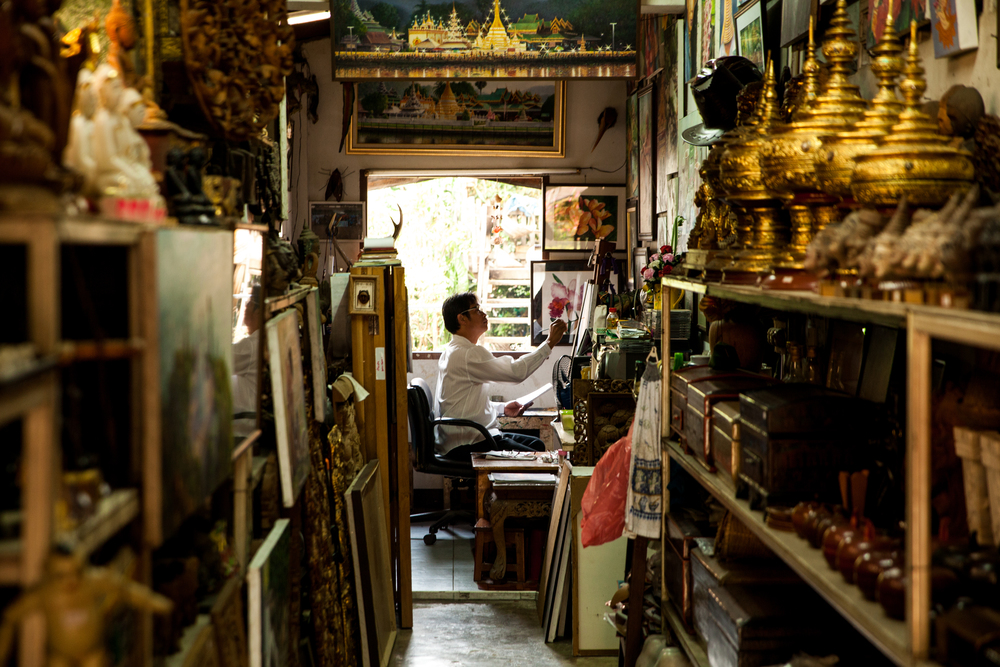 A professional painter at work in his shop/studio.  This sums up the atmosphere in Mae Hong Son, a peaceful place.