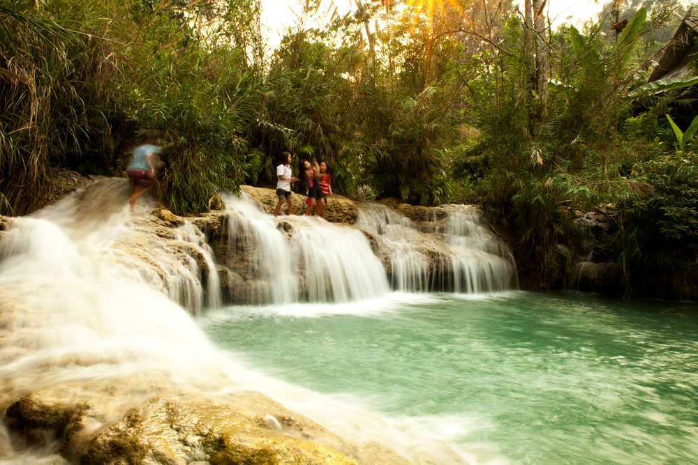The lower reaches of the Kuang Si waterfall.  These girls were having the most fun. Ever.