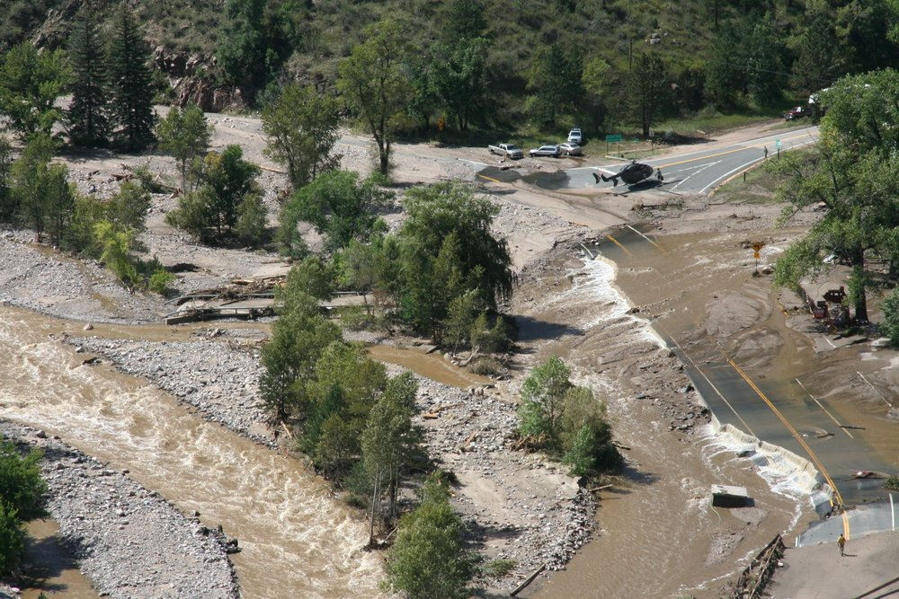 Below: Drake, Colorado. The Big Thompson River re-occupied the entirety of the Active River Corridor during the 2013 flood, flanking bridges and depositing sediment eroded from upstream reaches and captured during hillslope failures triggered by river movement. Photo: Civil Air Patrol.