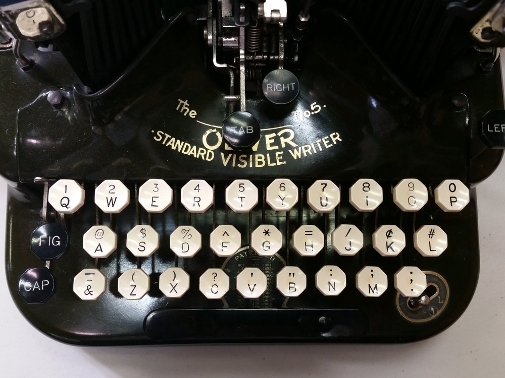 notice the cap button on the left. Above it there is a Figure key. Each key had three impressions: lower case, upper case, or a figure (symbol).