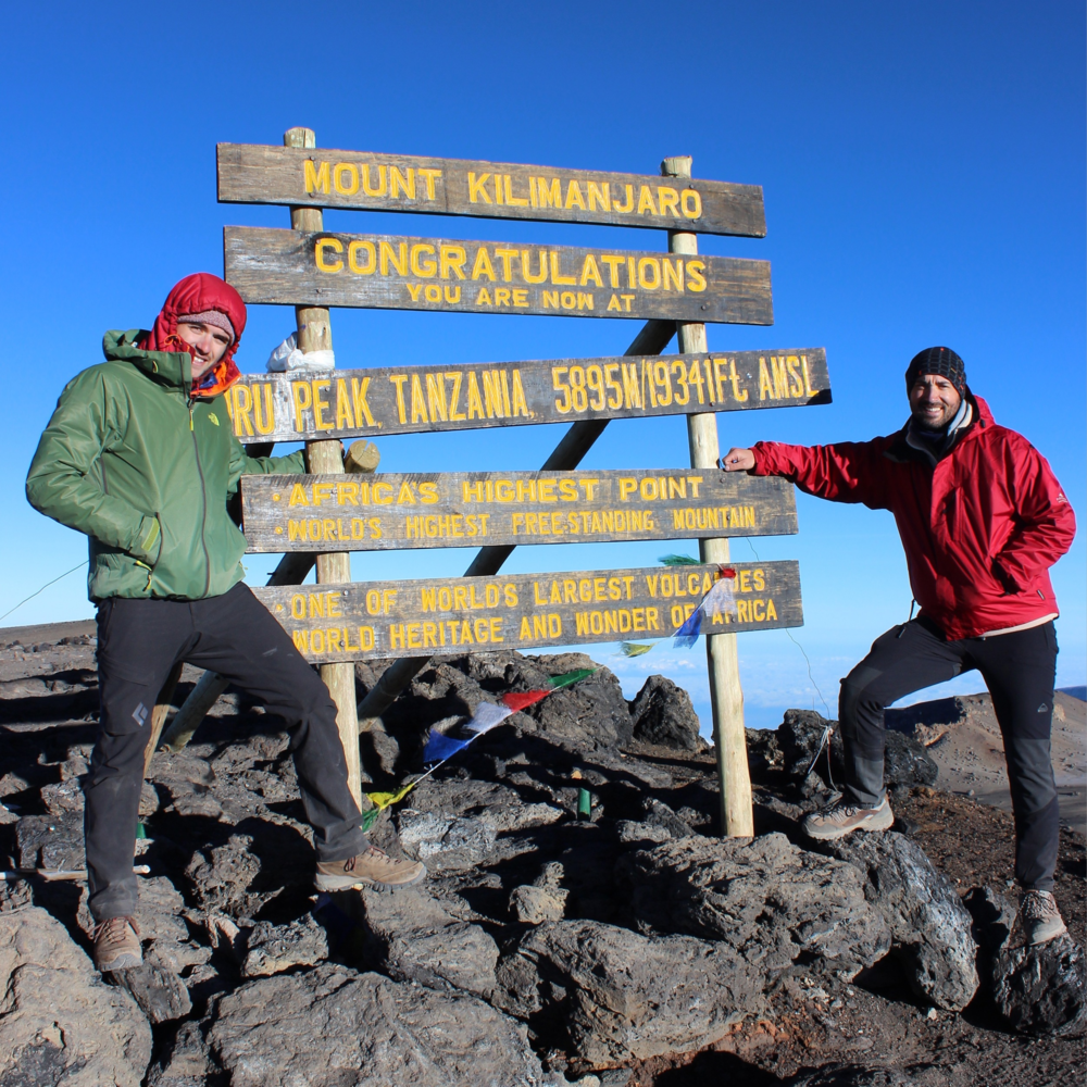 Andre and myself at the summit. Highest point in Africa and tallest freestanding mtn in the world.