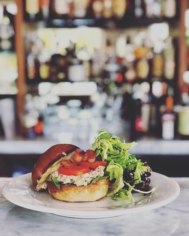 New lunch lunch special!  Albacore Tuna Melt Local from Monterey, seasoned with aioli, mustard, capers, cornichon, red onion, celery, and cayenne. Served on a delicious brioche bun with melted jack, lettuce, tomato, bacon and a side of mixed greens #oswald