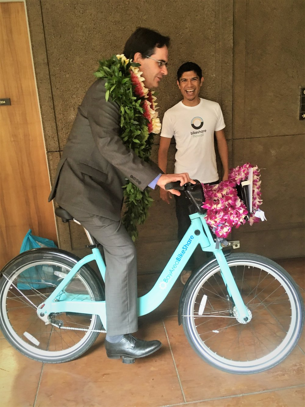 Senator Karl Rhoads of District 13 takes the bike for a spin down the hallways of the second floor