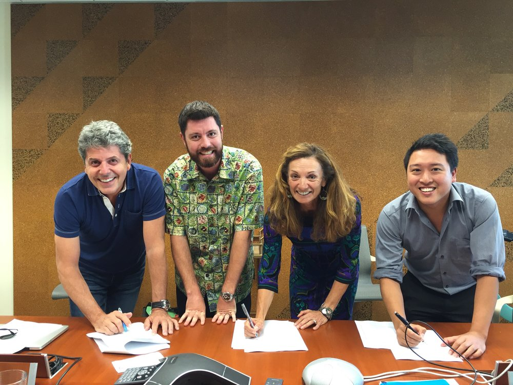 From L to R: Luc Sabbatini, CEO of PBSC Urban Solutions; Greg Gaug, Vice President of Ulupono Initiative and Bikeshare Hawaii Board Chair; Lori McCarney, CEO of Bikeshare Hawaii; and Kelvin Tjia, CEO of Secure Bike Share, sign the agreement.
