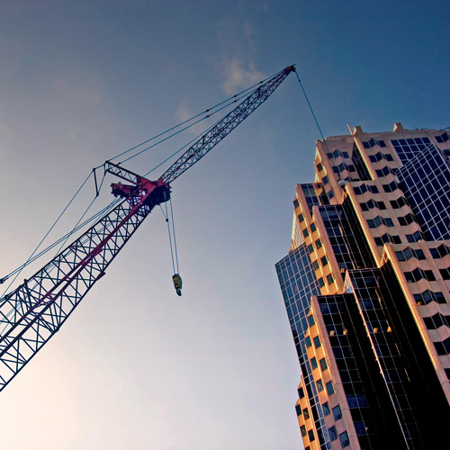 crane with high rise commercial office building