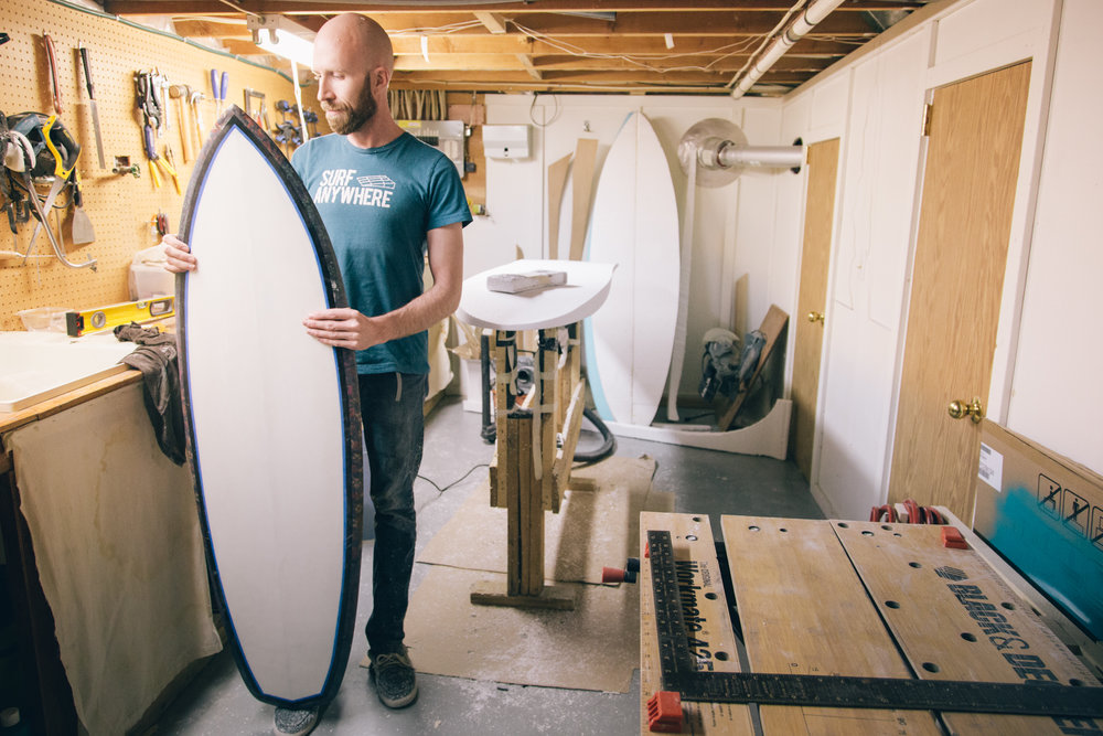 Adam showing off his babies first board he recently made.