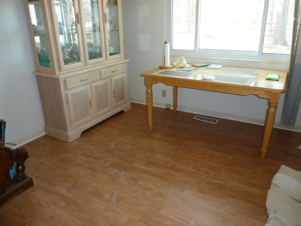 Installation of new laminate flooring to restore after water damaged the floors