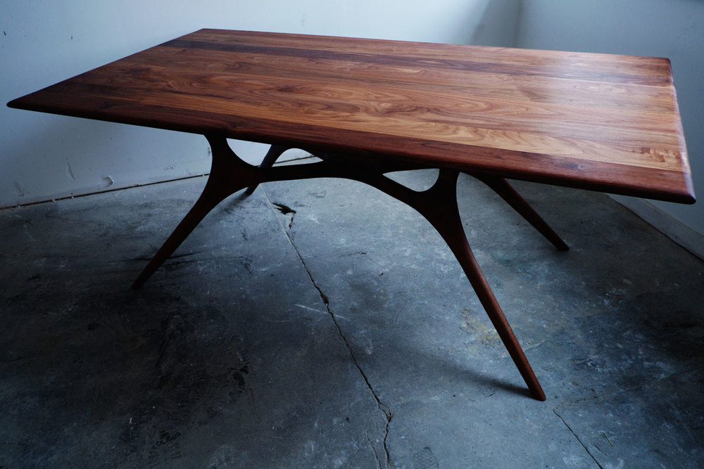 The walnut dining table by Weather Furniture