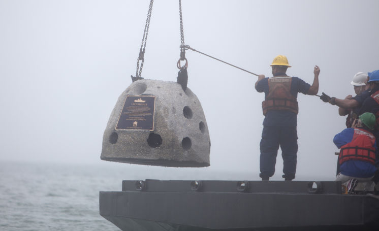 "Crew of the US Coast Guard Vessel ""VISE"" deploy the monument on January 15, 2015."