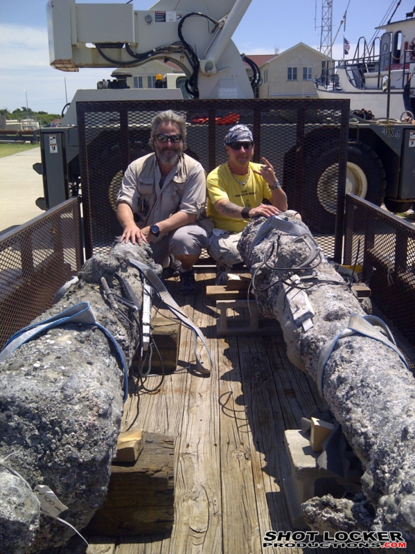 """The Shark Brothers with two of Blackbeard's largest guns. On location in Beaufort, NC. """"Blackbeard and the Queen Anne's Revenge""""."""