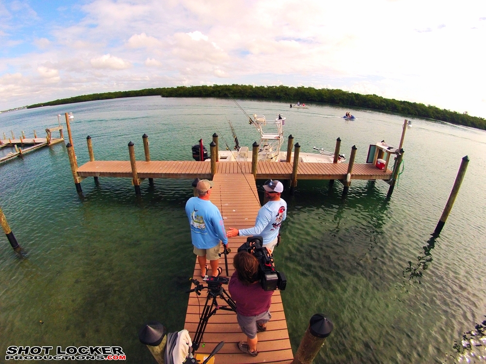 Joe Bamford Capturing the action with Capt. Chris ONeill (right) and Capt. Leroy Bennett on one of the docks at the WannaBinn.