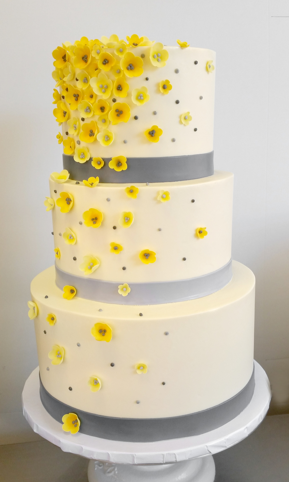 Yellow blossoms gray bands cake.jpg
