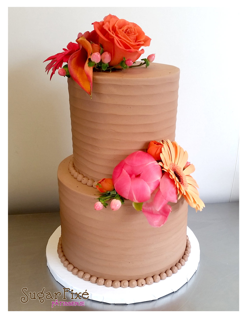 Chocolate Buttercream ripple texture fresh floral cake.jpg