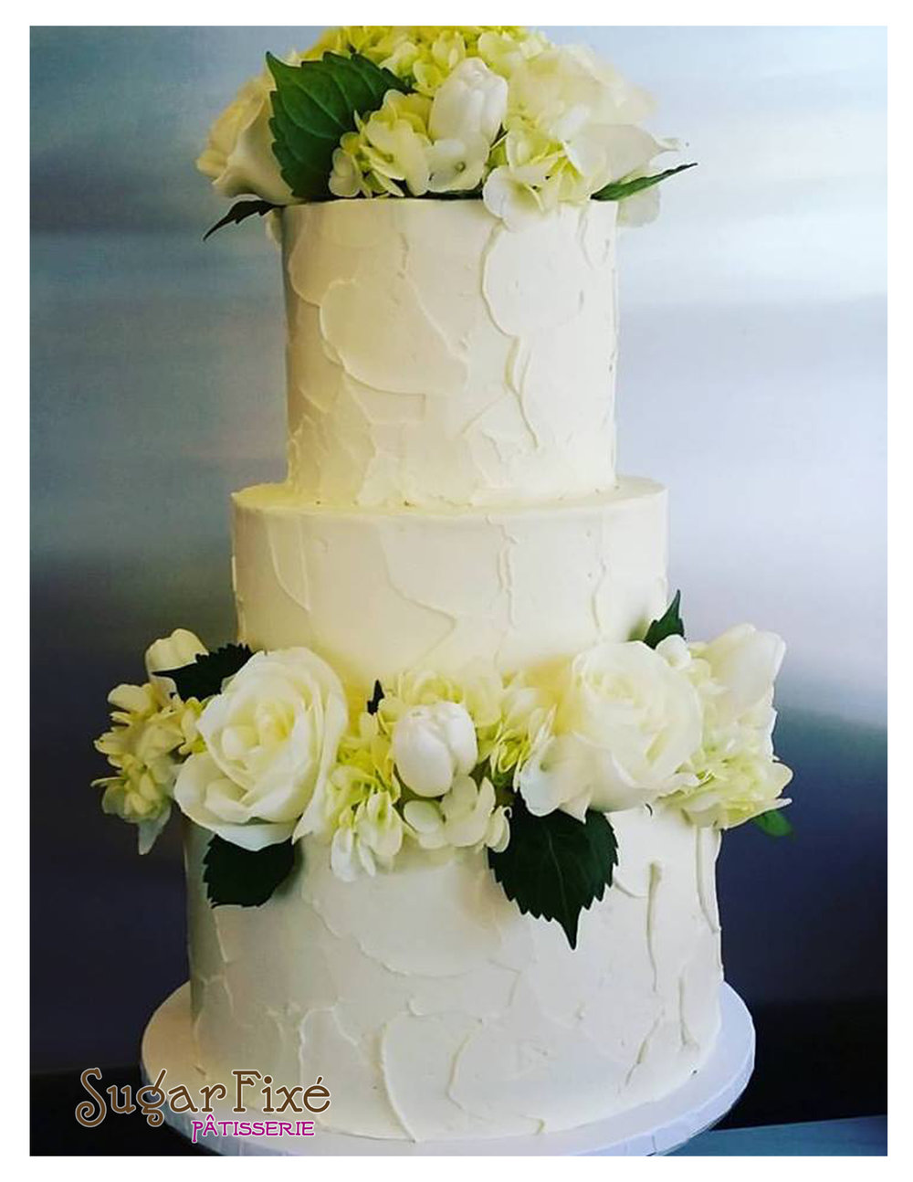 3 tier rustic fresh green and white florals.jpg
