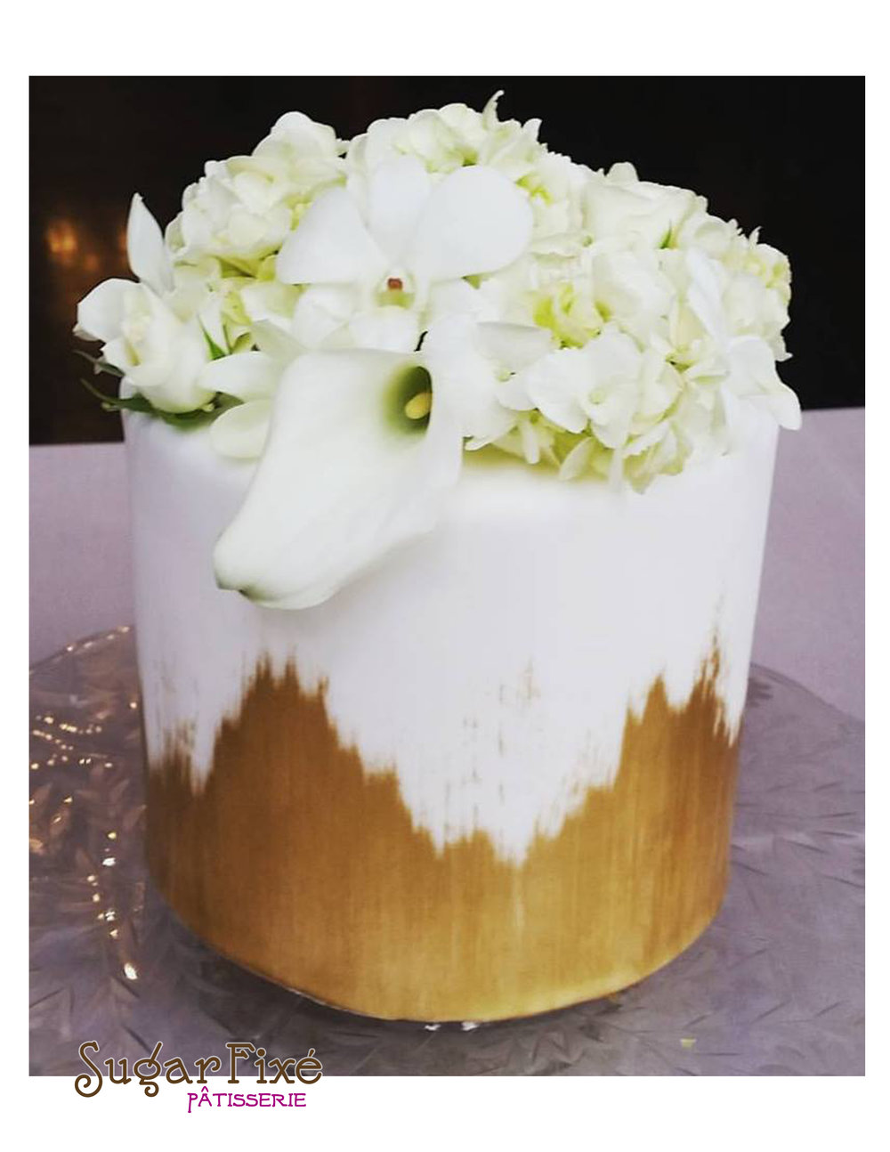 single tier gold brush fresh floral cake.jpg
