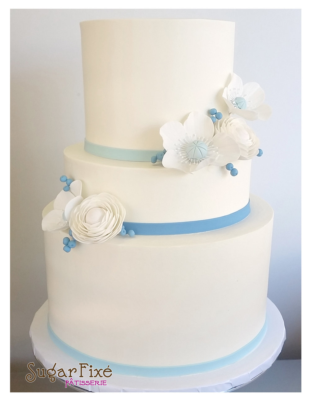 3 tier Blue gumpaste flowers.jpg