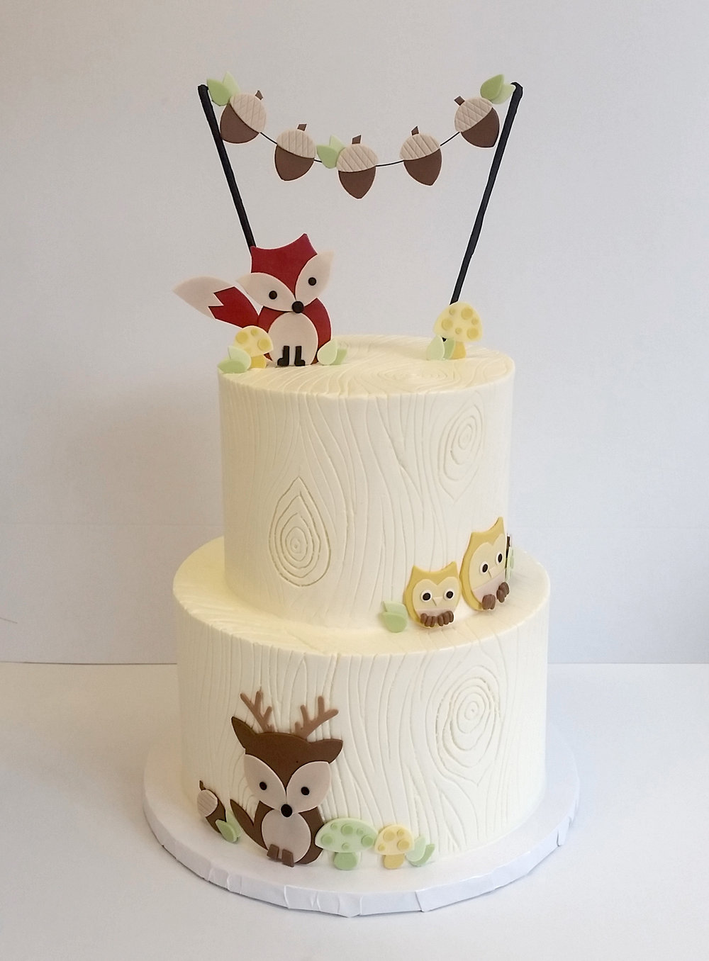buttercream woodgrain animals tiered.jpg