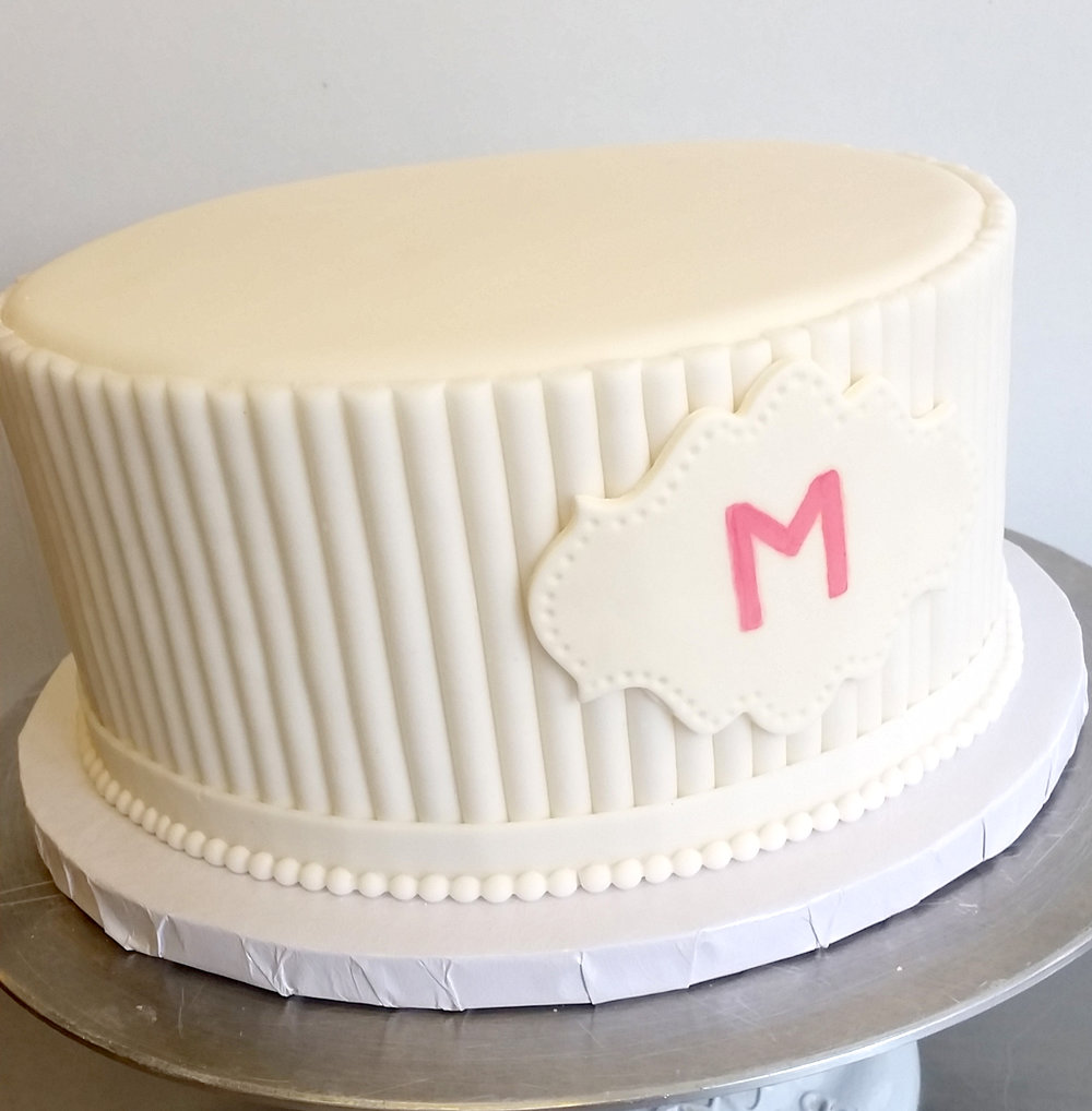 Fondant White texture cake with plaque.jpg