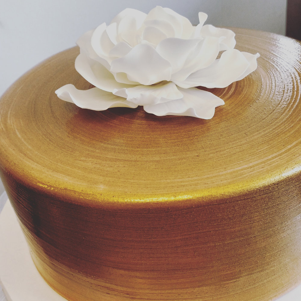 Gold painted with fondant flower.jpg